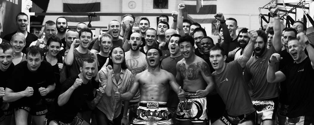 A group photo of muay thai legend saenchai and the students and trainers of Hanuman Thai Boxing in Edinburgh